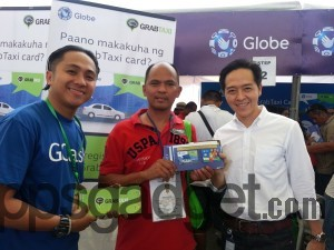 G-Xchange, Inc. Sales Issuance Director Albert Antig (right) with one of the first taxi drivers to enjoy the new GCash GrabTaxi Card